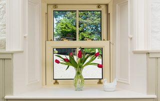 Tulips in a vase on windowsill