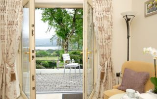 Double doors opening to overlook garden and Blessington lakes